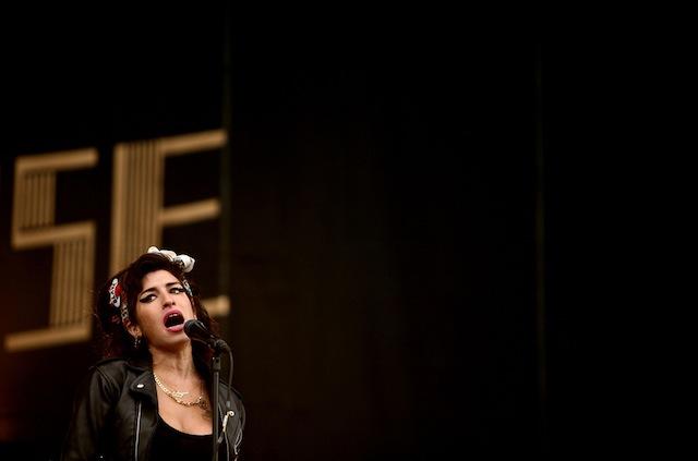 """Amy Winehouse canta durante il festival """"T In The Park Festival"""" a Kinross, in Scozia, 13 luglio 2008"""