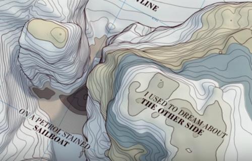 """Woodkid è tornato. Guarda il lyrics video di """"Land of All"""""""