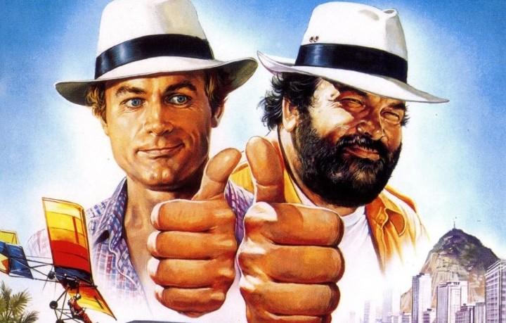 """Bud Spencer e Terence Hill, ovvero Carlo Pedersoli e Mario Girotti nella locandina di """"Non c'è due senza quattro"""" del 1984. I due si inventarono il western comico"""