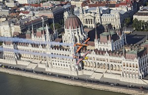 Martin Sonka of the Czech Republic and Nicolas Ivanoff of France fly above the Parliament prior to the fourth stage of the Red Bull Air Race World Championship in Budapest, Hungary on July 12, 2016.