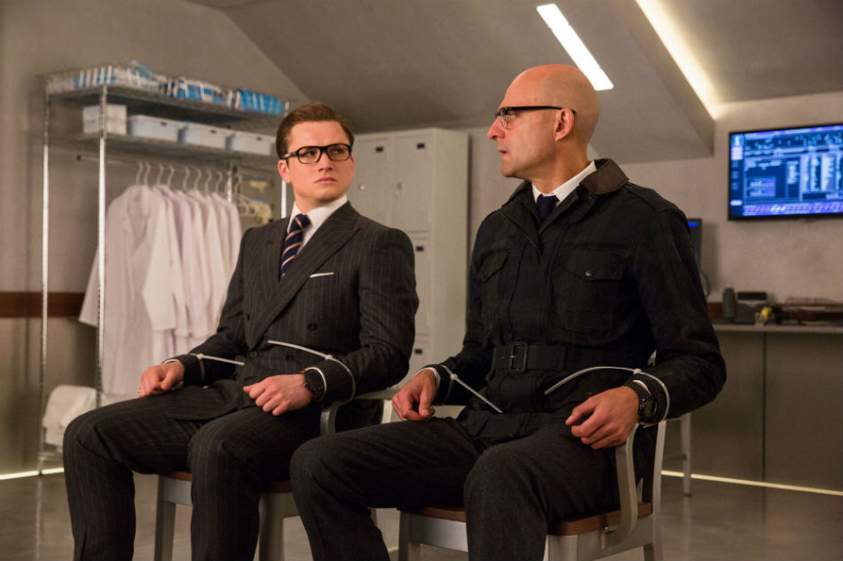 Gli agenti Kingsman Eggsy (Taron Egerton) e Mark Strong (Merlino) indossano l'orologio connesso TAG Heuer Connected Modular 45 Kingsman edition