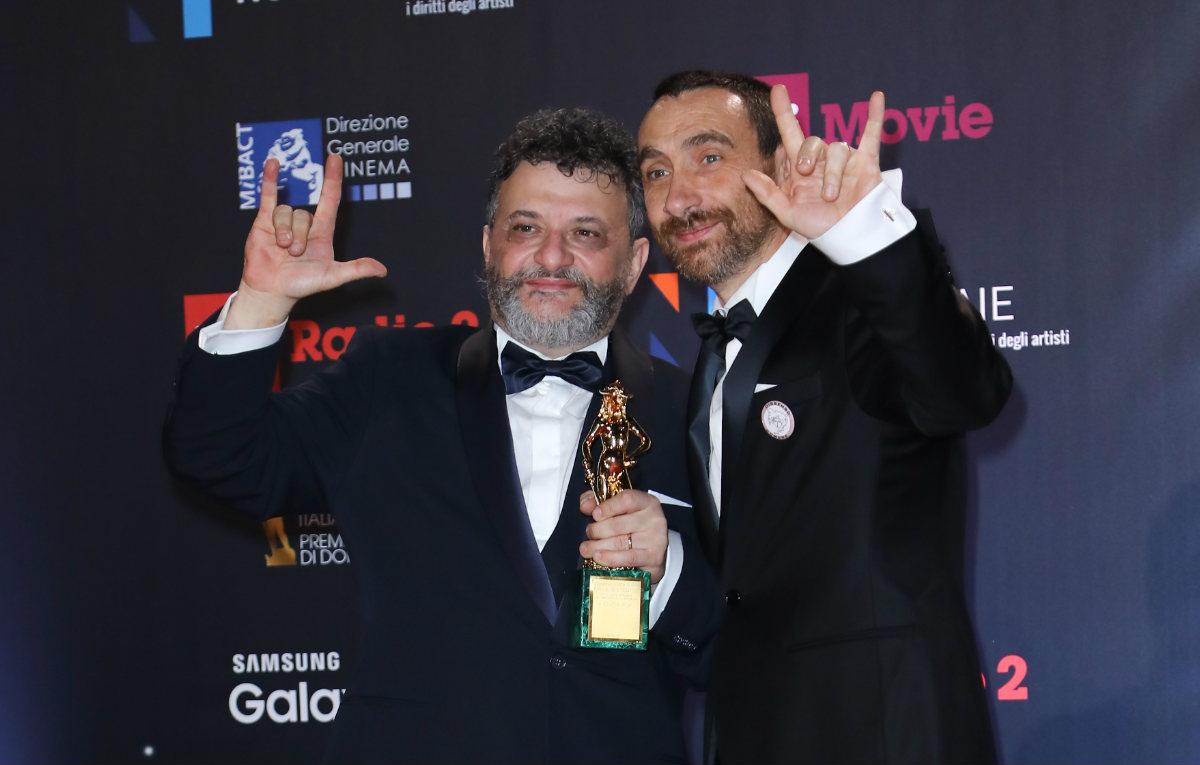 I Manetti Bros con il David per il miglior film. Foto IPA